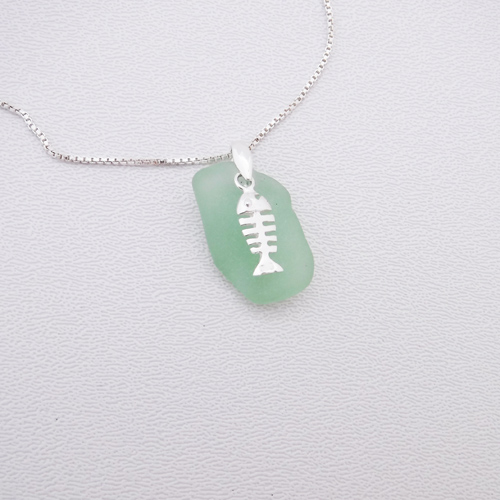 mint green sea glass necklace with bonefish 1